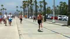 Skateboarding and bicycles riding in Santa Monica, BlackMagic 4K Camera Stock Footage