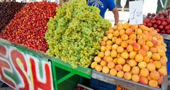shop of mixed fruit at the market in athens - stock photo