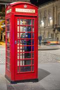Classic red British telephone box, night scene Stock Photos