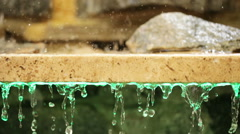 Granite slab with stones and waters Stock Footage