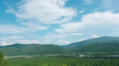 Summer landscape in mountains and the blue sky with clouds. Timelapse. - stock footage