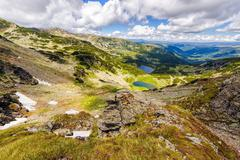 landscape with a glacial lake in the highlands of fagaras mountains, romania - stock photo