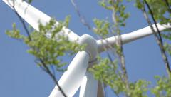 Windmill on Blue Sky with tree in the foreground! Stock Footage
