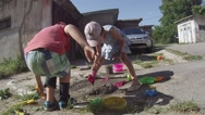 Stock Video Footage of Children play with mud in the yard.