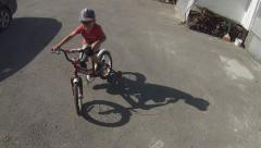 Bicycle with training wheels Stock Footage