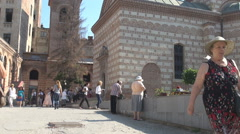 Sunday, church time, religious scene, people inside huge church yard, relaxing Stock Footage