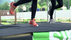 Two women doing aerobics on stage Stock Footage