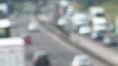 Blurry traffic moving slow shot taken from above Stock Footage