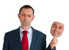Businessman concealing depression Stock Photos