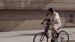Man on Bicycle Stares at Woman in Urban Scenic in 4K Stock Footage