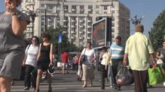 Sunny day, crowd crossing the road on stripped mark, commuting cityscape outside Stock Footage