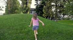 Slow-Mo: Rear View Of A Girl Reaching Top Of The Hill Stock Footage