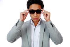 Portrait of a serious fashion asian man over white background Stock Photos
