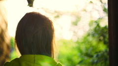 Girl listening to music in headphones outdoor Stock Footage