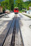 Diesel locomotive on a vintage cogwheel railway going to schafberg peak Stock Photos
