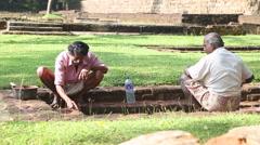 Man doing conservation work in Sigiriya, an ancient palace in Sri Lanka. Stock Footage