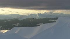 1080HD Cineflex shot of 2nd heli in snowy mountains Stock Footage