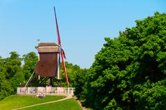 Windmill and green lawn at Brugge Stock Photos