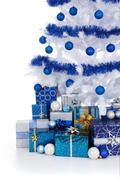 white cristmas tree with blue decoration - stock photo