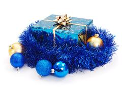 blue christmas gift surrounded with blue garland - stock photo