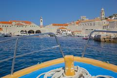 Approaching Old Town, UNESCO, by boat, Dubrovnik, Dalmatia, Croatia - stock photo