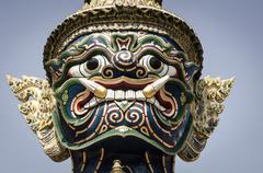 Mythical temple guard (Yaksha), Wat Phra Kaew, Bangkok, Thailand. - stock photo