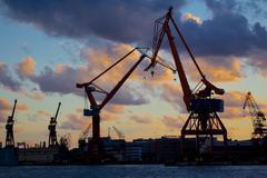 Dockyard cranes at sunset, Gothenburg, Sweden, Scandinavia, Europe Stock Photos