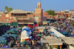 Kharbouch mosque and minaret, Jemaa-el-Fna Square, Marrakech, Morocco - stock photo