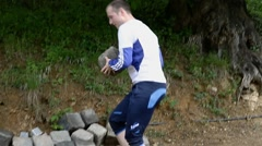 Man carrying stone blocks Stock Footage