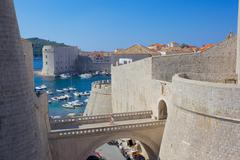 Harbour and Old Town walls, UNESCO, Dubrovnik, Dalmatia, Croatia - stock photo