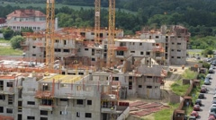 Housebuilding construction med pan time lapse 11377 Stock Footage