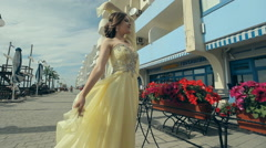 Beautiful attractive girl in lemony long rich strapless dress enjoy her life Stock Footage