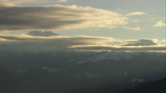 1080HD Cineflex mountains through clouds Stock Footage
