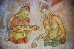 Apsara Frescoes on Mirror Wall at Sigiriya Rock Fortress, Sri Lanka, Asia - stock photo