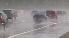 Cars and trucks driving on the highway in heavy rain storm Stock Footage