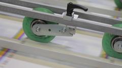 Paper rolling thru a machine - Close Up 2 Stock Footage