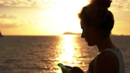 Stock Video Footage of Happy Calm Woman Use Smart Phone against Sunset