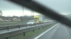 Driving on highway in slow motion wipers removing rain from windshield Stock Footage
