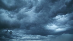 dark storm clouds are moving fast at viewer - timelapse - stock footage