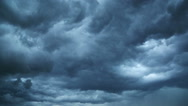 Dark storm clouds are moving fast at viewer - timelapse Stock Footage