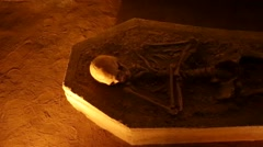 Skeleton laid down in a tomb inside a cave - stock footage