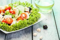 Fresh vegetable salad with cheese and olives Stock Photos