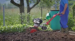 Cultivating earth with multikultivator - stock footage