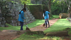 The view of women working in Sigiriya, an ancient palace located in Sri Lanka. Stock Footage