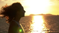 Stock Video Footage of Happy Lifestyle. Curly Girl Enjoying Sunset. Close up. Slow Motion.
