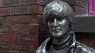 Stock Video Footage of john lennon statue, the beatles in mathew street, liverpool, england