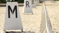 Horse Dressage Rings letter post and field fence Stock Footage