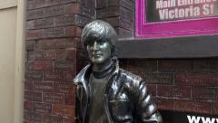 Zoom in, john lennon statue, the beatles in mathew street, liverpool, england Stock Footage