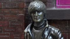 Zoom, john lennon statue, the beatles in mathew street, liverpool, england Stock Footage