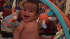 Happy baby at the playing area zoom in Stock Footage